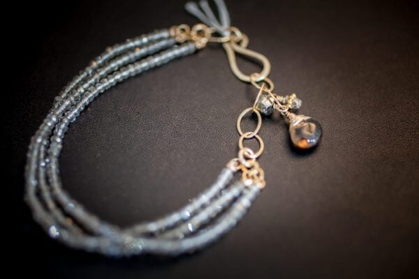 Beaded Three Strand Bracelet With Charm